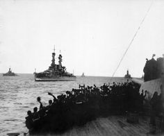 Sailors on board HMS 'Queen Elizabeth' cheering the arrival of four United States Navy battleships at Scapa Flow, December 1917. HU 82275