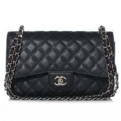 Chanel Black Quilted Caviar Classic Jumbo 2.55 Double Flap Bag with Silver hardware.