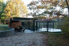 Too modern for my taste, but this house built as Bruce Wayne's home in Batman vs Superman is stunning! Located in Orion County, MI, this house fits on the edge of a small lake surrounded by gorgeous fall foliage. It doesn't hurt that that's also my dream car, the Aston Martin DB Mark III.