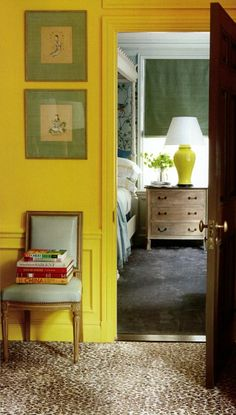 Citron yellow hall with leopard carpet looking into a gorgeous Chinoiserie master bedroom. Note how the hall color is picked up by the ceramic lamp in the bedroom. Gorgeous work by Nick Olsen.