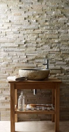 Create a statement with Roane Quartzite Maxi Splitface and the Lavastone Pebble Basin. #bathrooms #basin #contemporary #wall #stone http://www.mandarinstone.com/products/splitface/roane_quartzite_maxi_splitface#