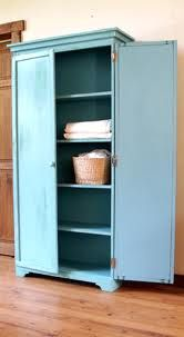 Make bookshelf into armoire by adding doors and molding/ either for food or dishes and glasses