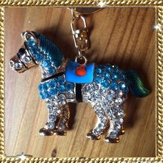 """Blue Crystal Horse Keychain, Fob, Purse Charm I will create a personal listing if you are interested in purchasing. Glimmering blue & diamond color crystals. Horse saddle is painted enamel. Back of horse has multiple heart filigree detail. Weighty but not heavy. Approximately 4""""H x 2.5""""L. Please ask if you have questions. Accessories Key & Card Holders"""