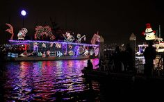 Boats cruise through Newport Harbor in Newport Beach on the first night of the annual Christmas Boat Parade and Ring of Lights on Wednesday....