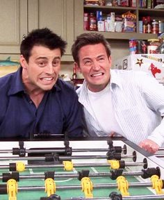 Joey and Chandler - Last episode. Where the chick and the duck are stuck in the table!