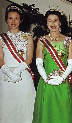 Norman Hartnell also designed the beautifully tailored two-tone green dress worn by Queen Elizabeth II (R) during a State Visit to Austria in 1969, where she's pictured with Princess Anne