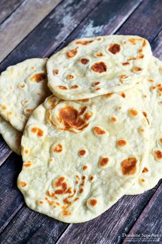 Homemade Naan - this is the easiest and quickest bread recipe you will ever make! Naan can be used for homemade pizzas, sandwiches, and more!