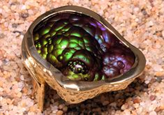exceptional Fire Agate, 30 carats, mined at Deer Creek in Arizona, set in custom 18 karat gold ring