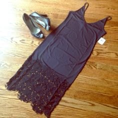 """NWT Free People Slinky Full Slip XS NWT Free People Slinky Full Slip XS lace hem combo makes for sultry media style on a sleeveless midi. V-neck, approx 40"""" length, 92% poly 8% spandex. Notice lace at bottom is cut which is intentional, not a flaw or second. Make an Offer! Free People Intimates & Sleepwear Chemises & Slips"""