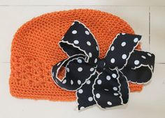 halloween hat..Simple buy knit hat & add any bow you like...can do it for any holiday (christmas,easter) You choose the color & look..let 'em know U LUV YOUR HOLIDAY IN STYLE ;)