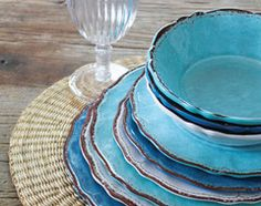 We love using Melamine dishes-they work great outdoor or indoors and will not blow away in windy climates. Our favorite is a brand called Le cadeaux. It is triple weight and comes in great patterns.  Check out more at http://www.outonthepatio.com/Le-Cadeaux-Melamine-Plates-s/41.htm 20 Ideas for Easygoing Summer Parties