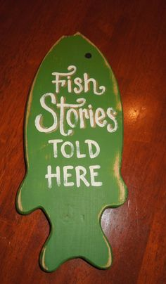 "Hand painted  ""Fish Stories Told Here"" wooden fish sign on Etsy, $11.00"