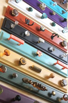 Colored upcycled hook racks.
