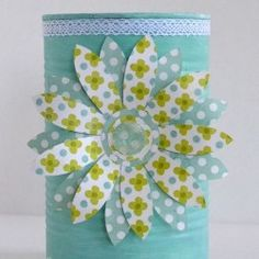 I upcycled tin cans with chalk paint and a paper flower attached with a magnet for a contributor post on Or So She Says--CURATED COLLECTION - TIN CAN CRAFTS | Looksi Square