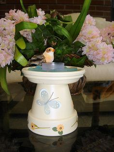 Painted terra cotta pot & saucer w/ blue beach glass around tealight candle. Clay Pot Projects, Clay Pot Crafts, Diy Clay, Clay Flower Pots, Flower Pot Crafts, Potted Christmas Trees, Flower Pot People, Diy Bird Bath, Painted Clay Pots