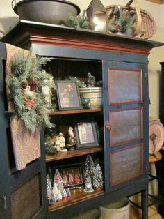 Wonderful things in this great pie safe!!!  Makes me want to open our pie safe this Christmas and decorate the inside!  Definitely doing this!