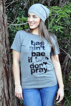 """This Shirt is another cute method way to talk about being evenly yoked in relationships according to 2 Corinthians 6:14. Bae ain't bae if bae don't pray! Printed on a poly-cotton deep heather tee. A unisex shirt for women and men!Model 5'6"""" wearing a Small Unisex"""