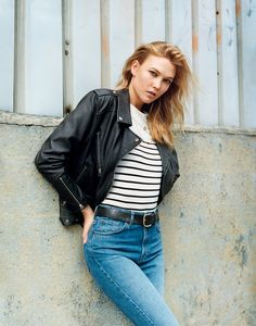 Karlie Kloss in Topshop striped shirt, leather jacket, and jeans.