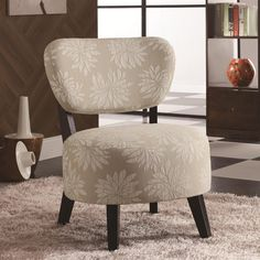 Spice up any room with this light floral accent chair with padded seating and dark brown wood legs. Accent Furniture, Furniture Decor, Living Room Furniture, Furniture Design, Dining Rooms, Floral Accent Chair, Brown Accent Chair, Armless Accent Chair, Accent Chairs