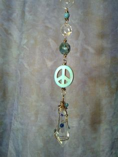 Teal Peace Sign Sun Catcher by CherylwoodForest on Etsy