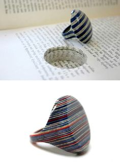 jewelry out of books by laminating hundreds sheets of paper together. The paper is selected and carefully removed from a book, and the jewellery re-inserted in the excavated space. Each piece is impossible to replicate, and is unique to the wearer.