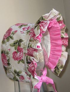 Reminiscent of years gone by, this vintage looking but entirely new baby bonnet is simply beautiful. The colors on the large roses are muted, giving 1 of 2