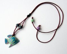 Terracotta pendants shaped fish decorated with slips with by Egeo, €18.00