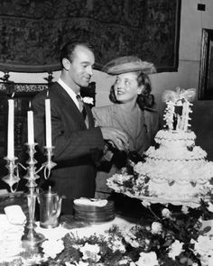 Bette Davis cuts the cake with husband William Grant Sherry on December 3, 1945