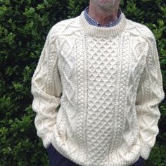 The design on this Saddle Shoulder #Aran  #Fisherman sweater incorporates the traditional Irish knitting patterns/stitches: Blackberry stitch, Moss stitch, Diamond and Cable patterns are all included. The cable pattern extends across the saddle shoulder at the rear to give a fine definition. Blackberry stitch fills the main panel, with cable patterns flanking it on either side accompanied by the diamond pattern at the edge. Hand knit in 100% pure wool.