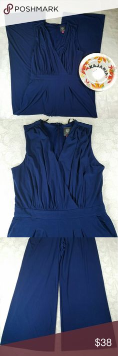 "Vince Camuto Jumpsuit. Size M Vince Camuto Jumpsuit. Size M.  Like new. No rips or stains. Gently worn. Very pretty dark blue. Zipper on back.  2 pockets on waist. Wide legs. Perfect for any occasion. Missing the string at waist.  The top part has lining same color.  95% polyester 5% spandex.  Measurement laying flat, bust 18"", waist 15 1/2"", inseam 30"" This is like the one on the last pictures but whitout the waist string... Vince Camuto Pants Jumpsuits & Rompers"