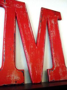 I painted an aged letter for our house. This started as a clearance letter from Hobby Lobby, about 2 feet tall. It has a coat of aqua and red paints, each with plaster of paris mixed in. The final coat is a medium wood stain for a bit of age. Red Paint, Hobby Lobby, Decorating Your Home, Something To Do, Crafty, Retro, Sign Letters, Hobbies, Wood Stain