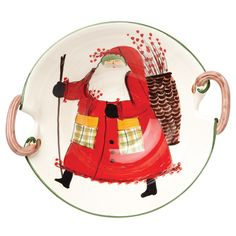 The Old St. Nick Large Handled Deep Serving Bowl features Old St. Nick setting out on a walk with a basket of holly berries on his back and is handpainted by maestro artisan Alessandro Taddei.