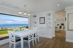 White Dining Room Design with Gorgeous Picture Window