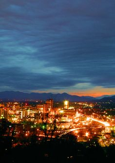 Dazzling downtown #Asheville after sunset over the Blue Ridge Mountains. Travel Guide: http://www.romanticasheville.com