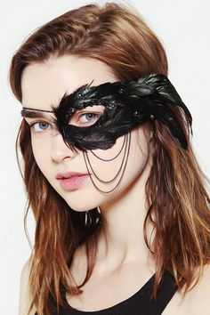 Mysterious, gorgeous one-eye feather mask with rhinestone detailing. #creepitreal