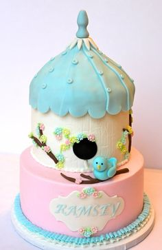 Birdhouse cake... this is a bit fancy for me, but I love the idea of making a 2-tiered cake into a birdhouse for a bird or garden themed birthday party!