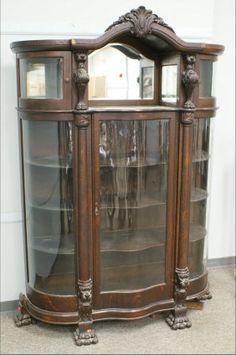 Bonnet top lion carved oak Victorian china cabinet