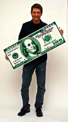 Artist Nathan Sawaya shows off a Hundred Dollar Bill made from Legos. Yes, I said Legos! See his online gallery The Art of the Brick at http://brickartist.com