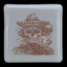 Fused Glass Coaster - Dia De Muertos 04 – Day Of The Dead – £7 each or £24 for a set of 4. Original drawings by Jiewsurreal (stock photos). All coasters measure approximately 10 x 10cm, with clear rubber bumpers on the base to keep them in place and protect your furniture. www.glassbygenea.co.uk #glassbygenea #fusedglass