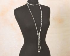 """A full view of this extra long necklace on a black neck form - looped once around the neck and then tied in a loop knot - hanging about 30"""". http://www.earthwhorls.com/product/labradorite-and-fresh-water-pearl-lariat-necklace-1395sn/"""