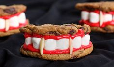 Dracula's Dentures :) Cookies, marshmallows, red icing, and maybe instead of using almonds use candy corn?