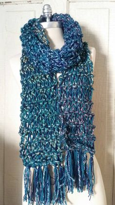 Check out this item in my Etsy shop https://www.etsy.com/listing/211379664/teal-blue-knit-scarf-chunky-knit-loose