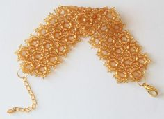 The honey comb design is very much in this season. Within the design industry, the hexagon has made a huge appearance in this years current designs. Did you know that a hexagon is the only shape with the most sides that can fit together perfectly? Here you can learn how to make your own honey comb cuff!