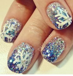 Snowflake and blue sparkles nail art