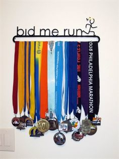 "From a Runner's World forum, a custom made medal display.  Great quote (from Shakespeare's Julius Caesar: ""Bid me run, and I will strive with things impossible."")"