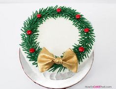 "Christmas Wreath Cake with Chocolate 3D Pine Needles! Simple tutorial on how to make this beautiful cake! This single tier 8"" buttercream cake would be lovely on your Christmas dessert table!"