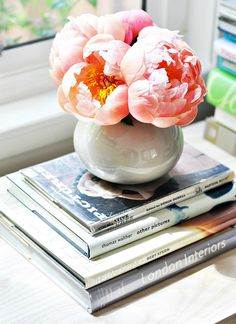 Add Peonies faux or real in vase on a stack of relationship books like The 5 Love Languages to attract a well balance mate DIY Feng shui