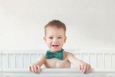 Baby boy in bowtie by erinbeck | Stocksy United