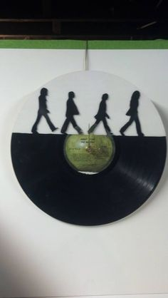 Iconic image of the Beatles on their Abby Road cover, scroll saw cut into a vinyl album - By Joe T.