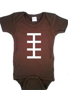 Football onesie - It is very easy to make your own football onesie. All you need is a brown onesie (Hobby Lobby), some white or ivory felt, and a needle and thread (or sewing machine). You can also use an embroidery hoop to make it easier.  Cut one long thin rectangle of felt. Sew it to the onesie using a back stitch. Cut 5 smaller felt rectangles and sew them on.
